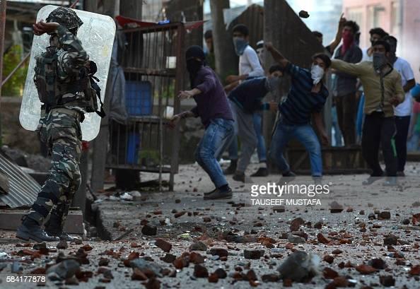 TOPSHOT Indian security force fired pellet gun towards Kashmiri protestors during a clash in Batmaloo area of Srinagar on July 28 2016 Indian Kashmir...