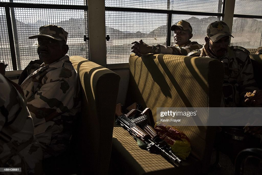Indian security force soldiers on election duty sit in a bus as they leave a central collection point to head for a polling station, on May 6, 2014 in Leh, Ladakh, India. India is in the midst of a nine phase election that began on April 7th and ends on May 12th. Ladakh voters will vote on May 7th.