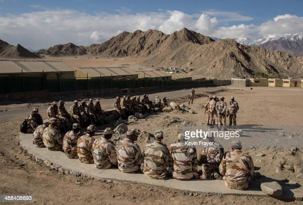 Indian security force soldiers on election duty wait to leave a central collection point to head to secure polling stations on May 6 2014 in Leh...