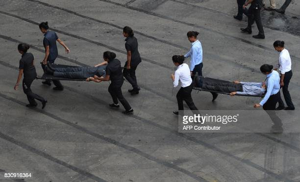 Indian security force take part in a mock drill during the fulldress rehearsal for the 71st Independence Day celebrations at the Red Fort in New...