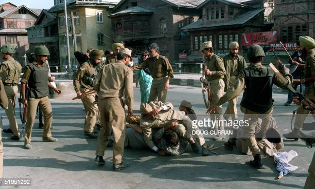 Indian security forces beat Muslim protesters 19 October 1993 during demonstration taken out during the curfew in Srinagar the summer capital of the...