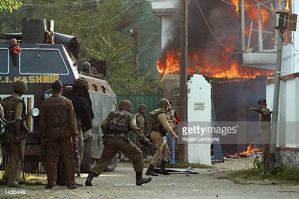 Indian security forces lay seige to a private home in Srinagar Kashmir India on the September 24 2002 The house was occupied by two miltants who had...