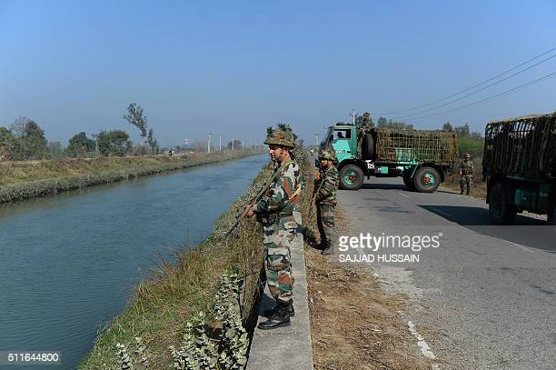 Indian security forces secure the Munak canal which supplies water to New Delhi near Bindroli village in Haryana's Sonipat district on February 22...