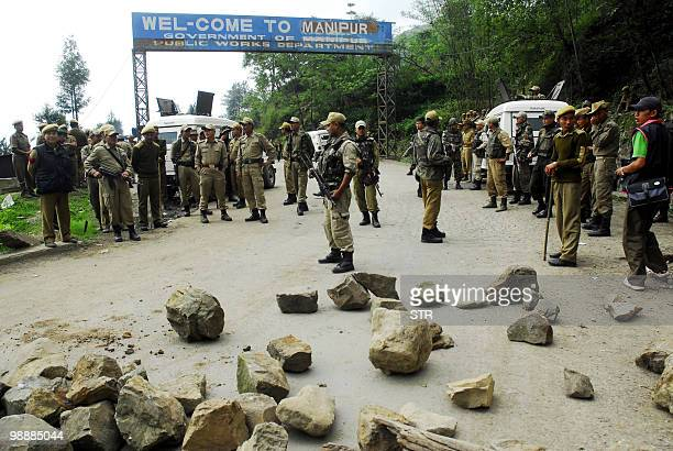 Indian security forces stand guard at the Mao Gate Bazar just after a crowd waiting to welcome a separatist leader was dispersed at the...