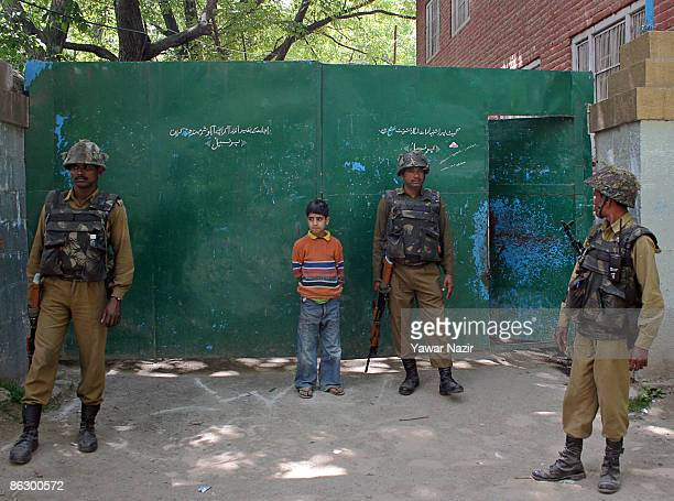 Indian Security forces stand guard outside the deserted polling station during the third phase of Indian parliamentary elections in Bijbehara 45 km...