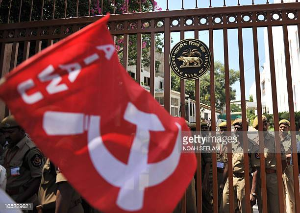 Indian security line the gate as Indian activists of The AllIndia Democratic Women's Association protest in front of the Reserve Bank of India...