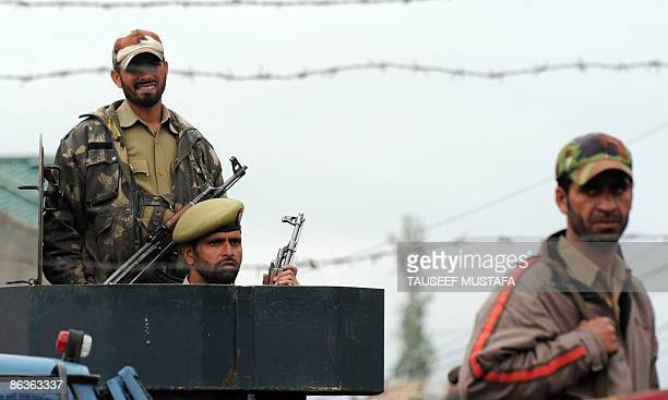 Indian security officials stand guard during an election campaign rally attended by Farooq Abdullah the former state chief minister and patron of...