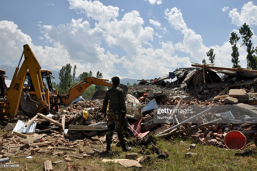 Indian security personal inspects the site of gunbattle in Khonshipora 25 miles west of srinagar on May 27,2016.Two rebels were killed by indian forces during a brief gunfight.