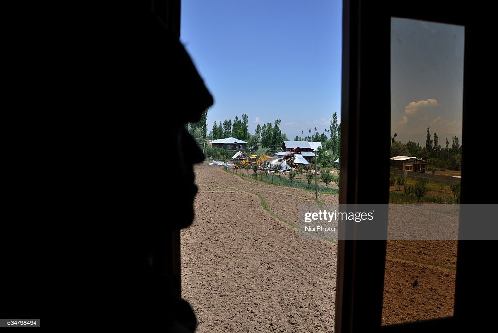 Indian security personal looks towards the gunbattle site in Khonshipora 25 miles west of srinagar on May 27,2016.Two rebels were killed by indian forces during a brief gunfight.