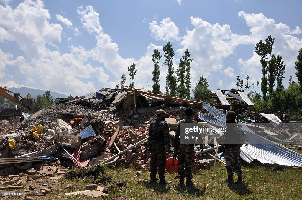 Indian security personals inspect the site of gunbattle in Khonshipora 25 miles west of srinagar on May 27,2016.Two rebels were killed by indian forces during a brief gunfight.