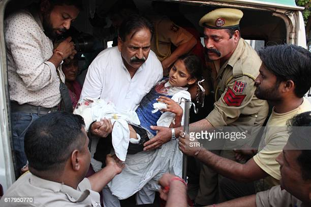 Indian security personnel bring an child allegedly wounded in crossborder fire from Pakistan to be treated at the Jammu Government Medical College in...