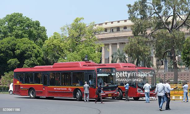 Indian security personnel check CNGrun buses being used to ferry MPs during the begining of the second part of the Budget session at Parliament in...