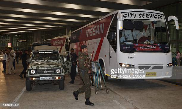 Indian security personnel guard the team bus for the Pakistan cricket team as they arrive for the T20 World Cup cricket tournament at the Netaji...