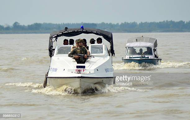 Indian security personnel patrol by speedboat along the IndoBangladesh border on the Brahmaputra River at Hatisingimari in South SalmaraMankachar...