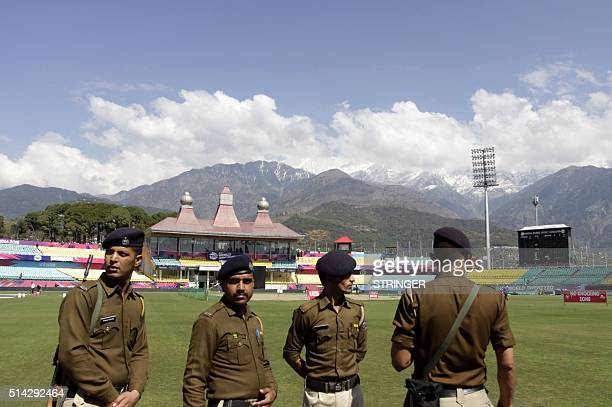 Indian security personnel stand alert ahead of the World T20 cricket tournament at The Himachal Pradesh Cricket Association Stadium in Dharamsala on...