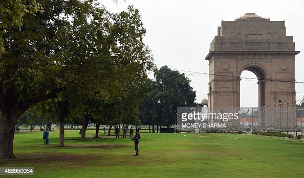 Indian security personnel stand guard near India Gate in New Delhi on August 14 on the eve of the country's Independence Day celebrations India...