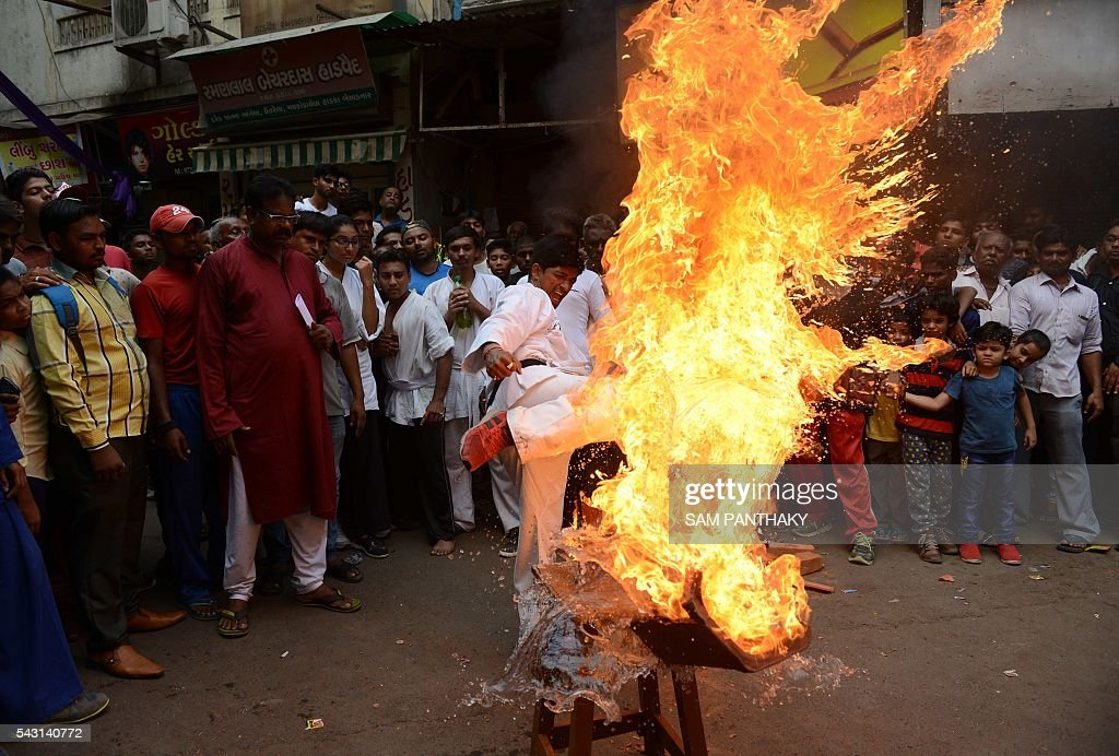 Indian self defence instructor Arvind Waghela performs with fire during a rehearsal for the forthcoming annual Rathyatra festival in Ahmedabad on June 26, 2016. The annual Rathyatra festival is scheduled to take place on July 6, 2016. / AFP / SAM
