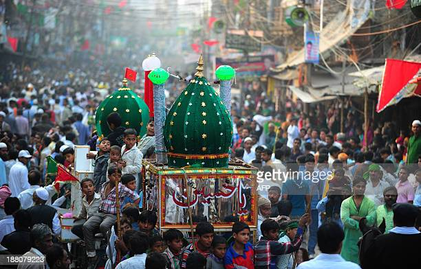 Indian Shiite Muslim devotees sit on a decorated float during a religious procession marking Ashura in Allahabad November 15 2013 Ashura mourns the...