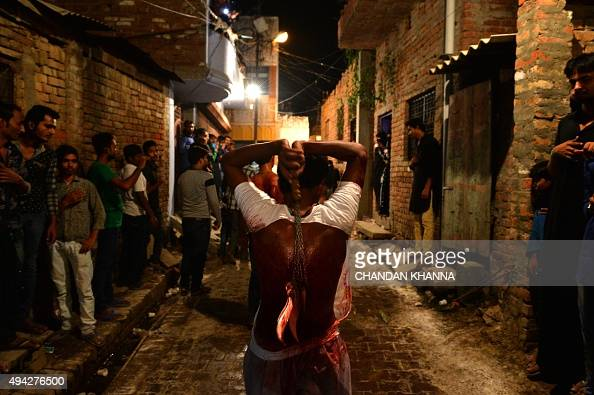 Indian Shiite Muslim devotees take part in ritual selfflagellation during a midnight Ashura procession in Allahabad on October 25 2015 Ashura mourns...