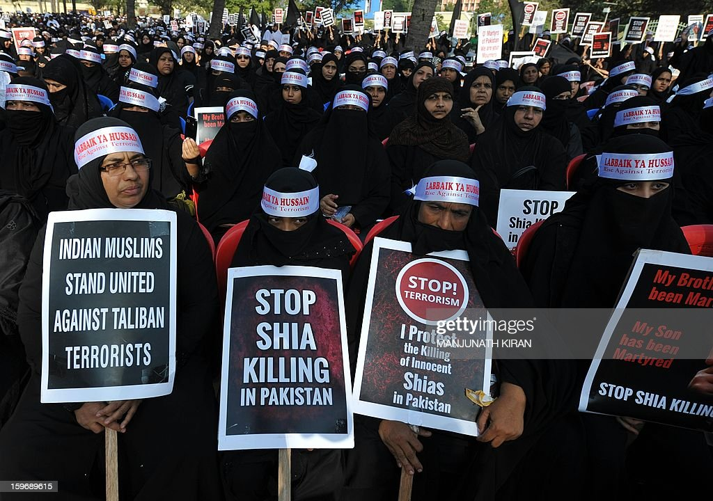 Indian Shiite Muslim women hold placards during a protest rally in Bangalore on January 18, 2013. The demonstrators were protesting against recent attacks against Shiite Muslims in Sunni-dominated Pakistan. AFP PHOTO/Manjunath KIRAN