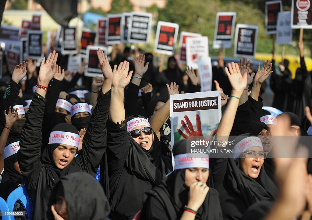 Indian Shiite Muslim women shout slogans during a protest rally in Bangalore on January 18, 2013. The demonstrators were protesting against recent attacks against Shiite Muslims in Sunni-dominated Pakistan. AFP PHOTO/Manjunath KIRAN