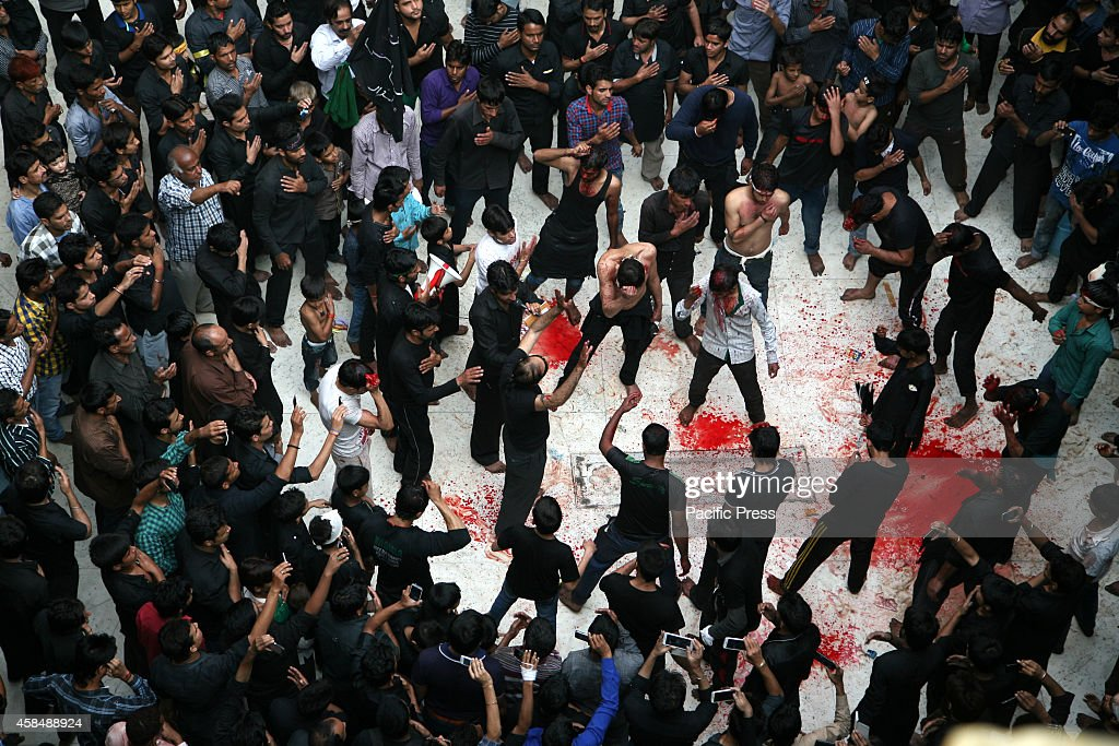 Indian Shiite Muslims flagellate themselves during an Ashura procession in New Delhi Shiite Muslims mark Ashura the tenth day of the month of...