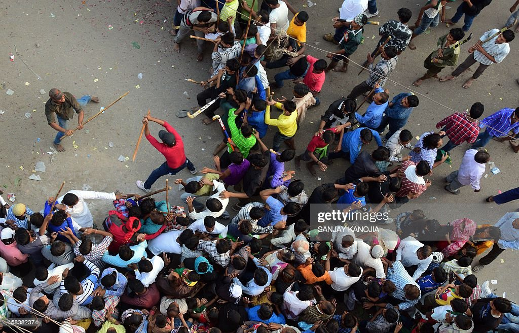 Indian Shiite Muslims participate in a mock fight during an Ashura procession in Allahabad on November 4 2014 During the Shiite Muslim holy month of...