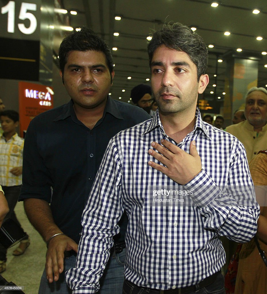 Indian shooter Abhinav Bindra arrives at Delhi Airport after winning Gold medal in the 10m Air Rifle event during the Glasgow 2014 Commonwealth Games...