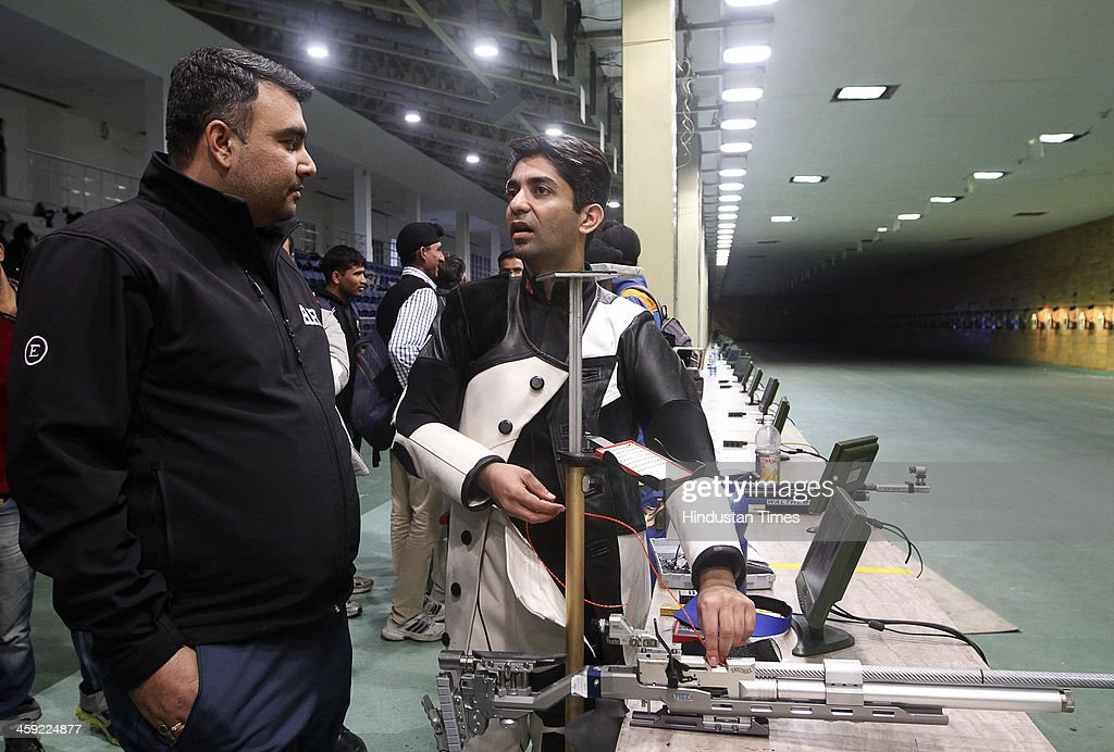 Indian shooter and Olympic gold medal winner <a gi-track='captionPersonalityLinkClicked' href=/galleries/search?phrase=Abhinav+Bindra&family=editorial&specificpeople=732431 ng-click='$event.stopPropagation()'>Abhinav Bindra</a> chats with compatriot Gagan Narang after winning 10-metre Air Rifle event's final round at National Shooting Championship, at Karni Singh Stadium on December 24, 2013 in New Delhi, India.