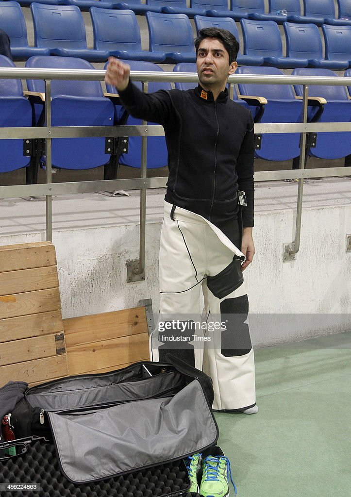 Indian shooter and Olympic gold medal winner <a gi-track='captionPersonalityLinkClicked' href=/galleries/search?phrase=Abhinav+Bindra&family=editorial&specificpeople=732431 ng-click='$event.stopPropagation()'>Abhinav Bindra</a> during 10-metre Air Rifle event's final round at National Shooting Championship, at Karni Singh Stadium on December 24, 2013 in New Delhi, India.