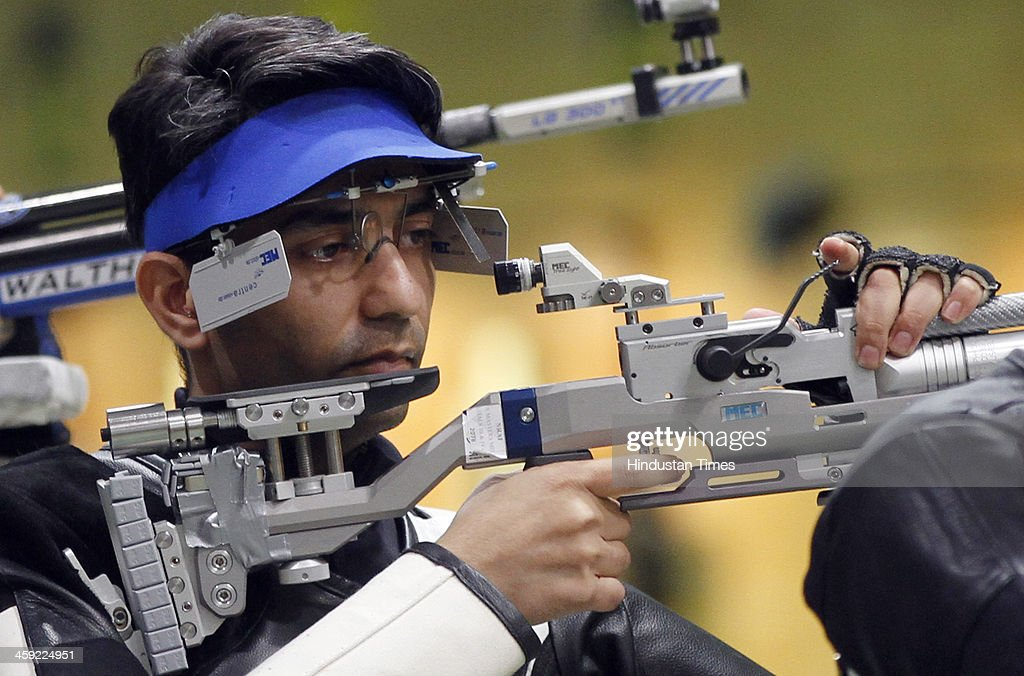 Indian shooter and Olympic gold medal winner Abhinav Bindra takes aim with rifle during 10-metre Air Rifle event's final round at National Shooting Championship, at Karni Singh Stadium on December 24, 2013 in New Delhi, India.