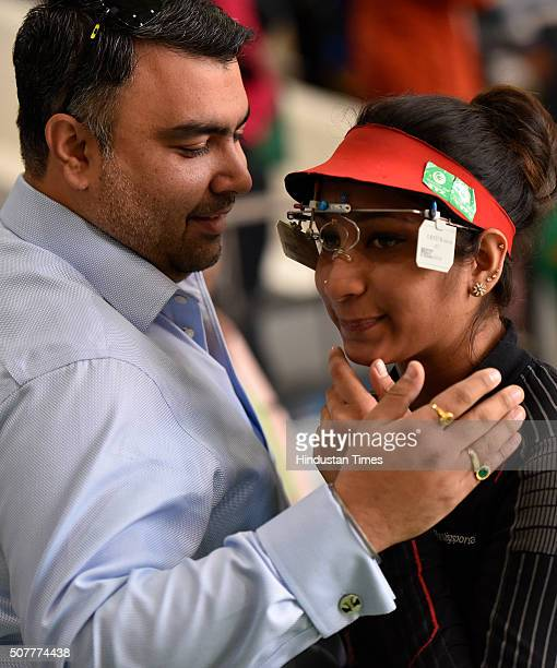 Indian Shooter Elizabeth Susan Koshy with Gagan Narang after losing a match during the Asian Olympic Qualifying Competition at Dr Karni Singh...
