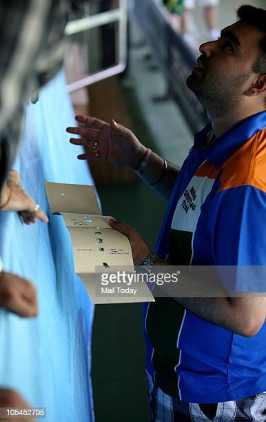 Indian shooter Gagan Narang reacts after failing to win a medal in the men's 50M rifle porne event of the Commonwealth Games at Dr Karni Singh...