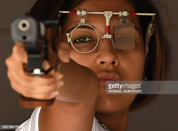 Indian shooter Heena Sidhu concentrates before taking a shot during a training session at the Maharshtra Rifle Association firing range in Mumbai on...