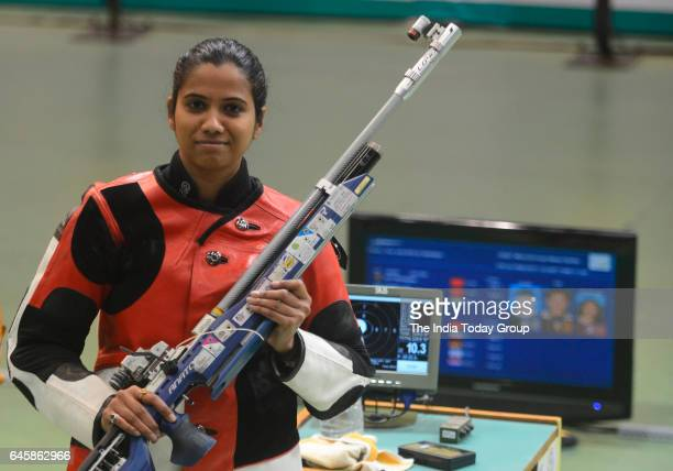 Indian shooter Pooja Ghatkar competes in the women's 10m air rifle shooting final during the ISSF World Cup Series 2017 in New Delhi