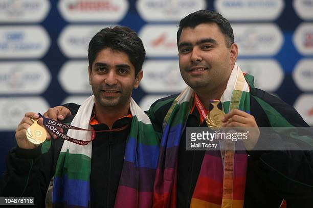 Indian shooters Abhinav Bindra and Gagan Narang showing their gold medals which they won in 10M Air Rifle Men event of Commonwealth Games at Dr K...