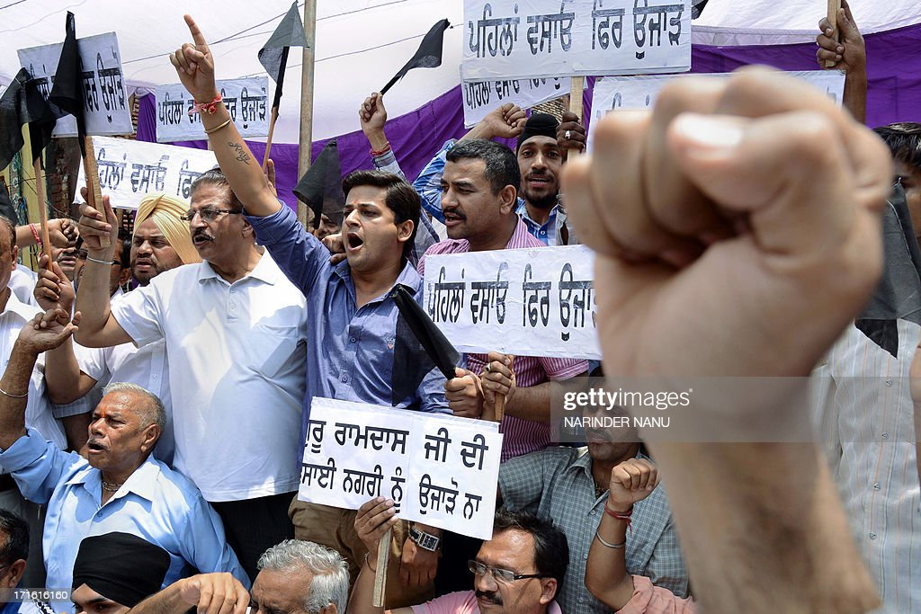 Indian shopkeepers protest against the Improvement Trust and Punjab Government outside the Jallianwala Bagh in Amritsar on June 27, 2013. After getting notice for vacating shops near the Jallianwala Bagh within 15 days, the protestors demanded that the authorities should rehabilitate them before vacating the shops.