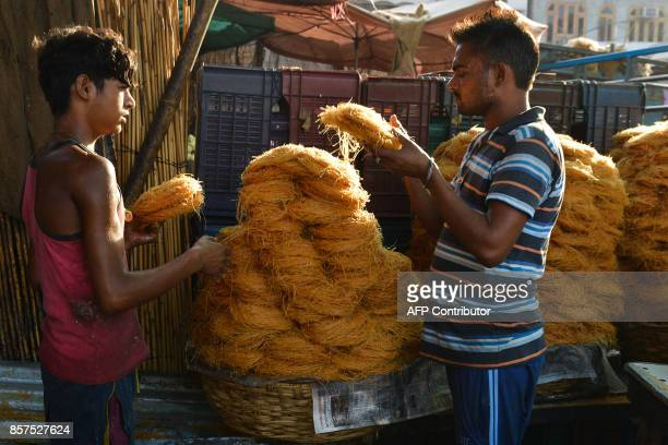 Indian shopworkers display vermicelli outside of a sweet shop in Amritsar on October 4 2017 Traditionally sweets are purchased for the coming Karva...