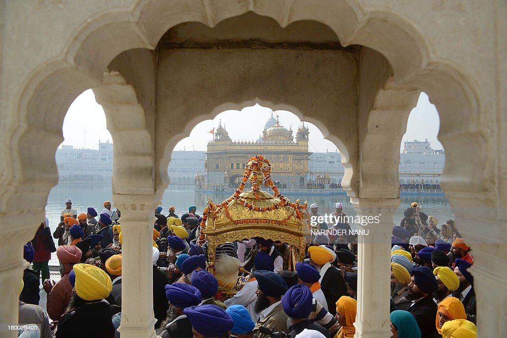 Indian Sikh devotees carry the Sikh Holy Book - Guru Granth Sahib - during a procession at the Golden Temple in Amritsar on January 25, 2013 on the eve of the 331th Birth Anniversary of Sikh warrior, Shaheed Baba Deep Singh. The Gurdwara Shaheed Bunga Baba Deep Singh at the Golden Temple commemorates the memory of Singh and his great deeds.