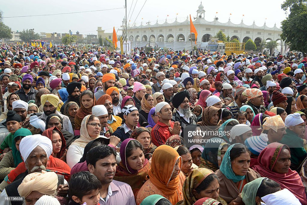 Indian Sikh devotees pay their respects at the Sikh Shrine Gurudwara Chheharta Sahib during Basant Panchami celebrations, 7 km west of Amritsar on February 15, 2013. Basant Panchami, the Festival of Spring, is celebrated to welcome spring.
