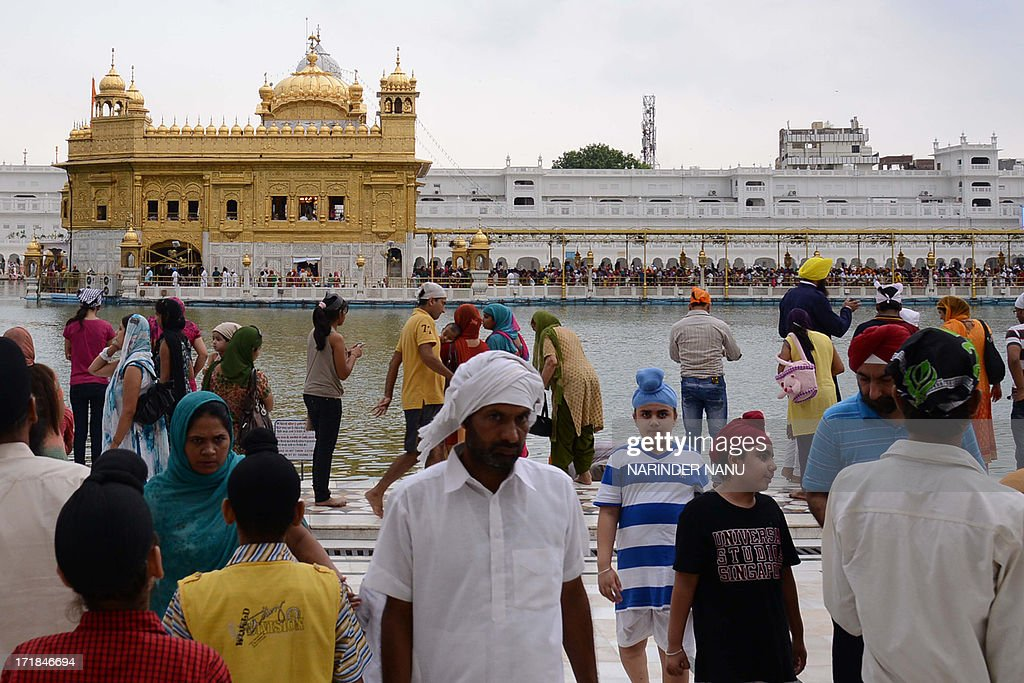 Indian Sikh devotees pay their respects at the Sikh Shrine, The Golden Temple in Amritsar on June 29,2013. On the occasion of the 174th death anniversary of Majaraja Ranjit Singh. Singh was also known as 'Sher-e-Punjab' or 'Lion of Punjab' and is remembered for uniting the Punjab as a strong nation and his possession of the Koh-i-noor diamond. Singh, who was born in Gujranwala in 1780, was the ruler of the Pakistani Punjab province and died on June 27, 1839.