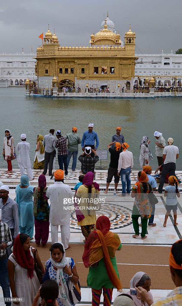 Indian Sikh devotees pay their respects at the Sikh Shrine, The Golden Temple in Amritsar on June 29,2013. On the occasion of the 174th death anniversary of Majaraja Ranjit Singh. Singh was also known as 'Sher-e-Punjab' or 'Lion of Punjab' and is remembered for uniting the Punjab as a strong nation and his possession of the Koh-i-noor diamond. Singh, who was born in Gujranwala in 1780, was the ruler of the Pakistani Punjab province and died on June 27, 1839. AFP PHOTO/NARINDER NANU
