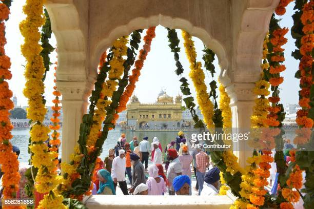 Indian Sikh devotees pay their respects on the eve of the birth anniversary of the fourth Sikh Guru Ram Das at The Golden Temple in Amritsar on...