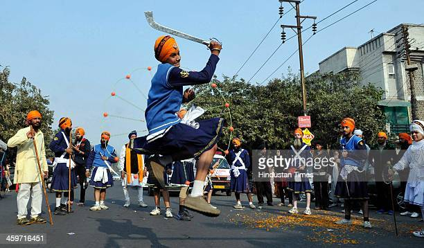 Indian Sikh devotees show their skill in martial arts during 'Nagar Kirtan' procession carried out as part of 'Prakash Utsav' the birth anniversary...