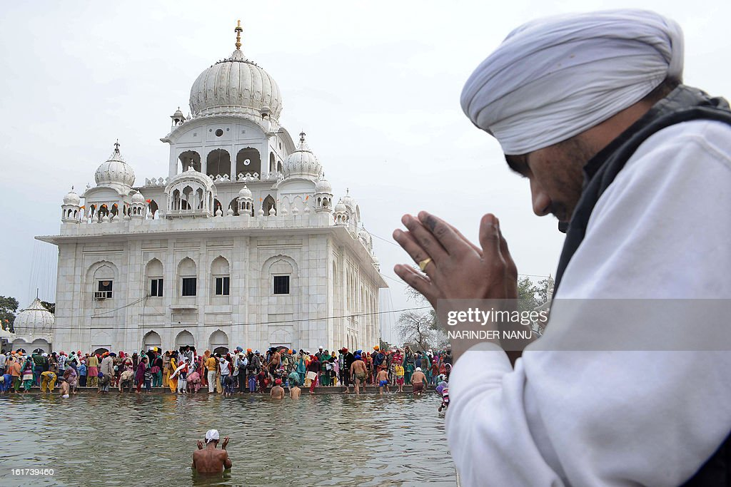 Indian Sikh devotees take a dip in the sarover (water tank) at the Sikh Shrine Gurudwara Chheharta Sahib during Basant Panchami celebrations, about 7 kms west of Amritsar on February 15, 2013. Basant Panchami, the Festival of Spring, is celebrated to welcome spring.