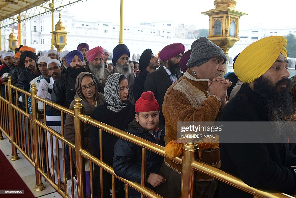 Indian Sikh devotees wait to pay their respects at the Sikh Shrine Golden Temple in Amritsar on January 18, 2013. Sikhs are celebrating the 348th Birth Anniversary of the tenth Sikh Guru Gobind Singh.
