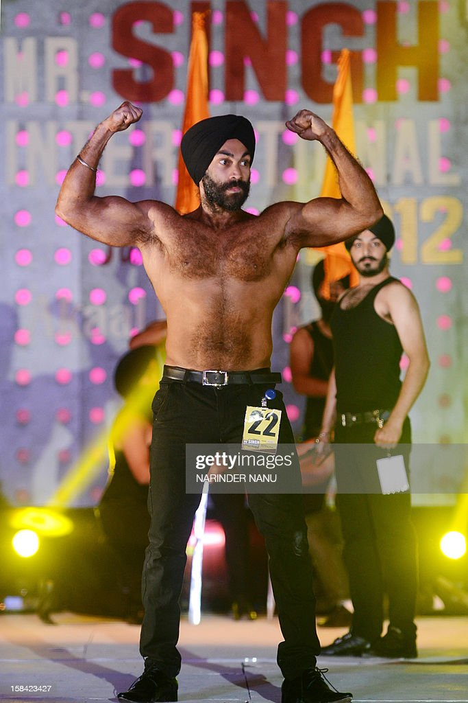 Indian Sikh models pose during the Mr. Singh International Turban Pride 2012 Fashion Show in Amritsar on December 16, 2012. A total of 26 contestants participated in the event which was organised by Akaal Purkh Ki Fauj. AFP PHOTO/ NARINDER NANU