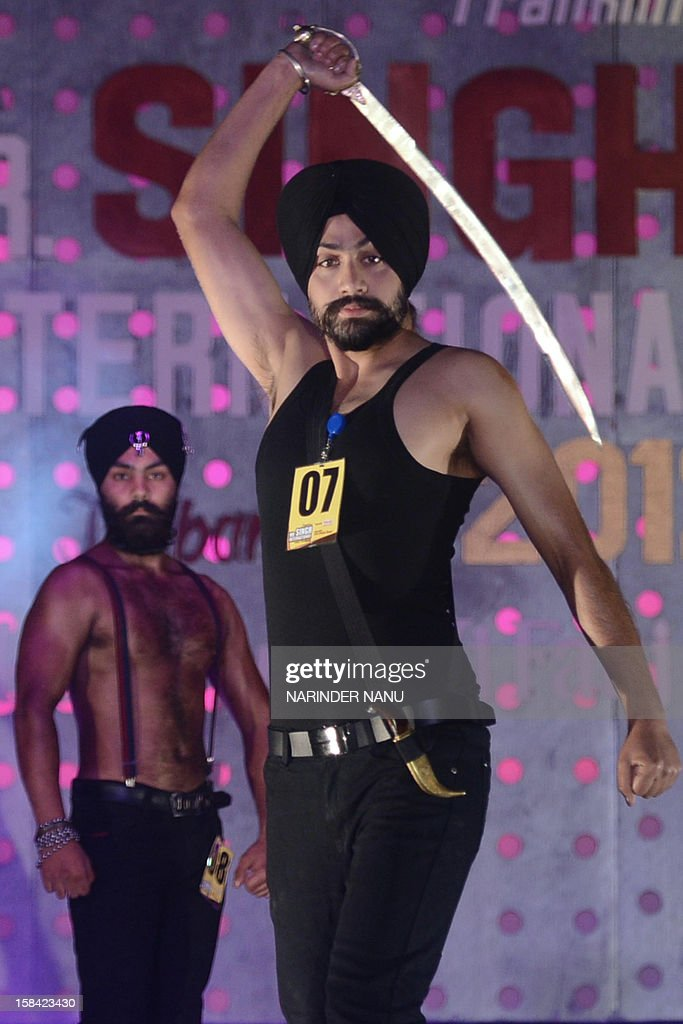 Indian Sikh models pose during the Mr. Singh International Turban Pride 2012 Fashion Show in Amritsar on December 16, 2012. A total of 26 contestants participated in the event which was organised by Akaal Purkh Ki Fauj.
