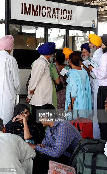 Indian Sikh pilgrims and Pakistani travellers wait at immigration at the Attari International Railway Station between India and Pakistan about 35 km...