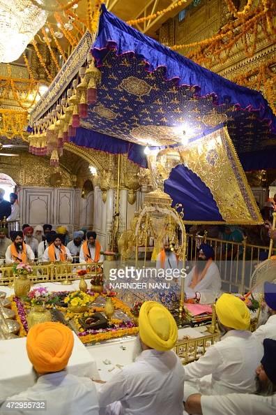 Indian Sikh Priests Sit Behind The Guru Granth Sahib Sikh Holy Book During A 39 Jalau 39 A